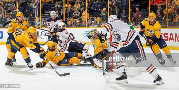 K Subban and Pekka Rinne of the Nashville Predators battle in the crease against Jujhar Khaira as Ryan Strome of the Edmonton Oilers centers the puck...