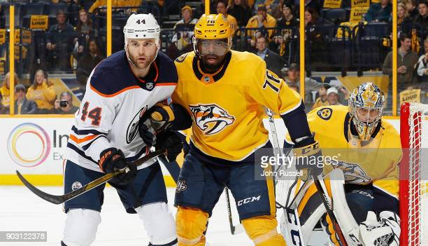 K Subban and Pekka Rinne of the Nashville Predators watch the action along the boards against Zack Kassian of the Edmonton Oilers during an NHL game...