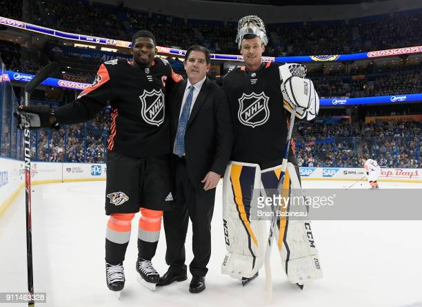 P K Subban head coach Peter Laviolette and Pekka Rinne of the Nashville Predators pose for a group shot during warmup prior to the 2018 Honda NHL...