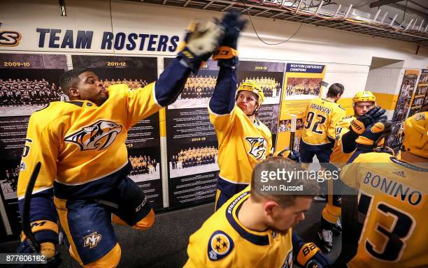 K Subban high fives Filip Forsberg of the Nashville Predators as they walk to ice during an NHL game against the Montreal Canadiens at Bridgestone...
