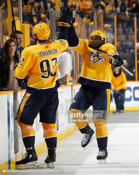 K Subban high fives Ryan Johansen of the Nashville Predators after a 32 win against the Chicago Blackhawks during an NHL game at Bridgestone Arena on...