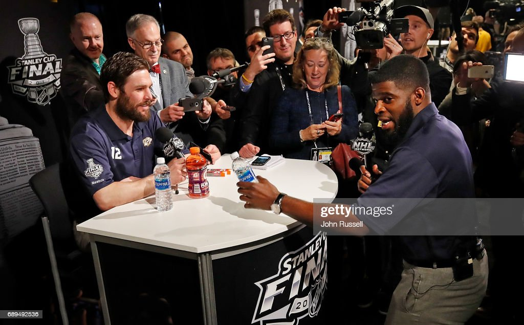 P.K. Subban #76 interviews team captain Mike Fisher #12 of the Nashville Predators during Media Day for the 2017 NHL Stanley Cup Final at PPG Paints Arena on May 28, 2017 in Pittsburgh, Pennsylvania.