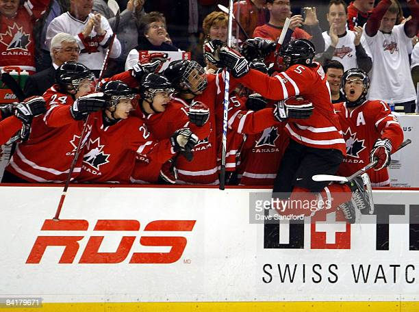 K Subban of Team Canada leaps into the arms of his teammates after Canada scored an empty net goal to seal their victory over Team Sweden during the...