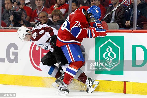 K Subban of the Montreal Canadiens and Matt Duchene of the Colorado Avalanche battle for the puck during the NHL game at the Bell Centre on October...