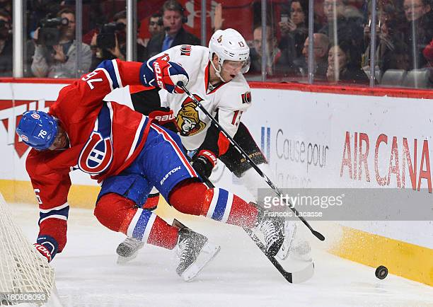 Subban of the Montreal Canadiens battles for the puck with Peter Regin of the Ottawa Senators during the NHL game on February 3, 2013 at the Bell...