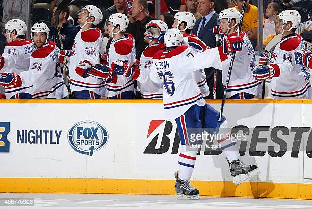 K Subban of the Montreal Canadiens celebrates his goal along the bench against the Nashville Predators at Bridgestone Arena on December 21 2013 in...