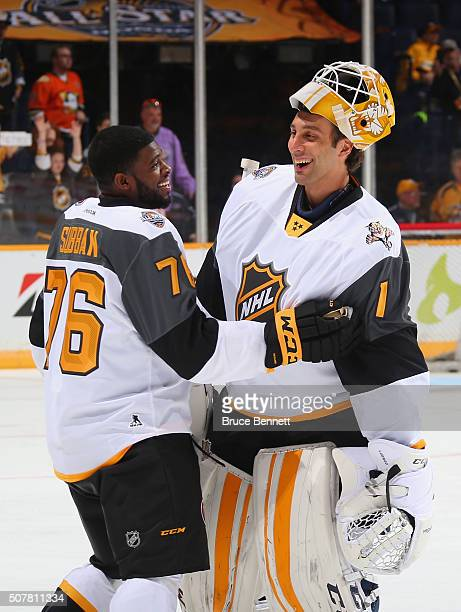 K Subban of the Montreal Canadiens greets Roberto Luongo of the Florida Panthers prior to the 2016 Honda NHL AllStar Game at Bridgestone Arena on...