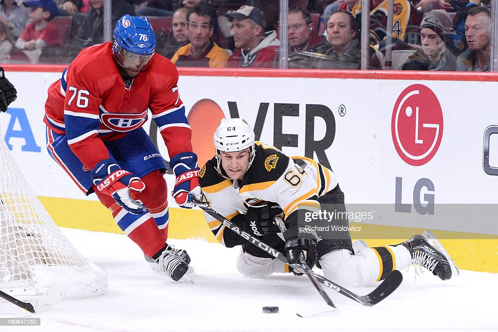 P.K. Subban #76 of the Montreal Canadiens hooks Lane MacDermid #64 of the Boston Bruins during the NHL game at the Bell Centre on February 6, 2013 in Montreal, Quebec, Canada.