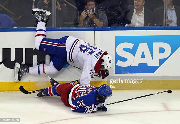 K Subban of the Montreal Canadiens is tripped up by Mats Zuccarello of the New York Rangers in Game Three of the Eastern Conference Final during the...