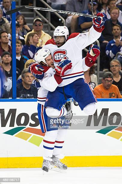 K Subban of the Montreal Canadiens jumps into the arms of Dale Weise after Weise scored the game winning goal against the Tampa Bay Lightning in...