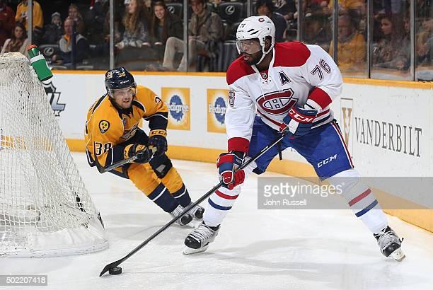 K Subban of the Montreal Canadiens skates against Viktor Arvidsson of the Nashville Predators during an NHL game at Bridgestone Arena on December 21...