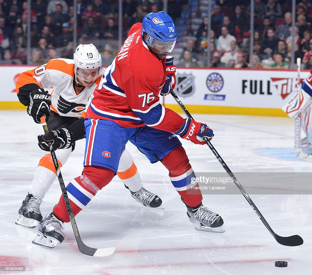P.K. Subban #76 of the Montreal Canadiens skates the puck away from Brayden Schenn #10 of the Philadelphia Flyers during the NHL game on February 16, 2013 at the Bell Centre in Montreal, Quebec, Canada.