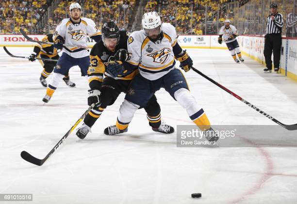 K Subban of the Nashville Predators and Conor Sheary of the Pittsburgh Penguins battles for the puck during the second period of Game Two of the 2017...