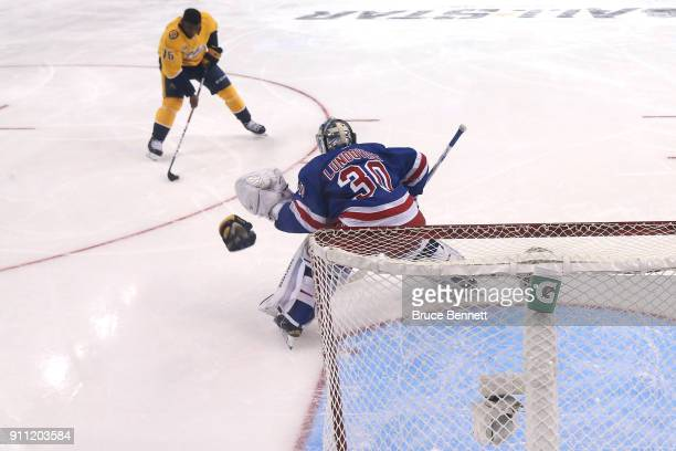 P K Subban of the Nashville Predators and Henrik Lundqvist of the New York Rangers compete in the GEICO NHL Save Streak during the 2018 GEICO NHL...