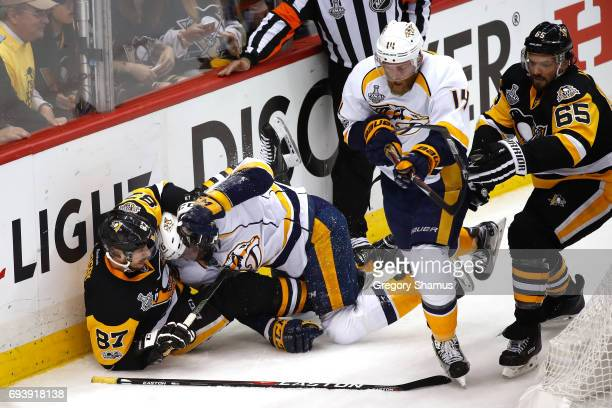 K Subban of the Nashville Predators and Sidney Crosby of the Pittsburgh Penguins fight in the first period in Game Five of the 2017 NHL Stanley Cup...