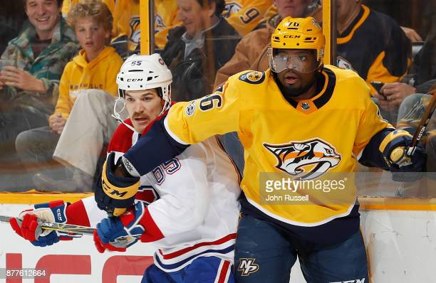 K Subban of the Nashville Predators battles against Andrew Shaw of the Montreal Canadiens during an NHL game at Bridgestone Arena on November 22 2017...