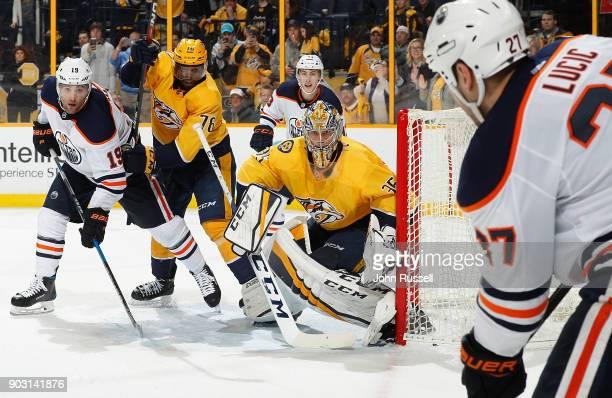 K Subban of the Nashville Predators battles against Patrick Maroon of the Edmonton Oilers as goalie Pekka Rinne eyes the puck on the stick of Milan...