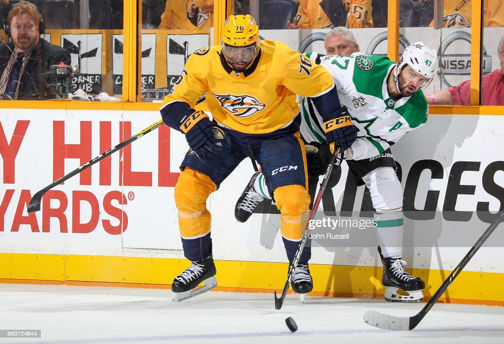 P.K. Subban #76 of the Nashville Predators battles for the puck against Alexander Radulov #47 of the Dallas Stars during an NHL game at Bridgestone Arena on October 12, 2017 in Nashville, Tennessee.