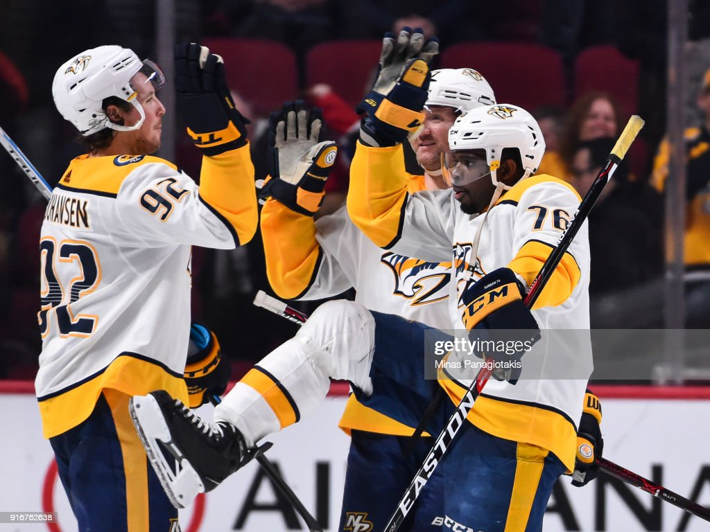 P.K. Subban #76 of the Nashville Predators celebrates a victory with teammate Ryan Johansen #92 against the Montreal Canadiens during the NHL game at the Bell Centre on February 10, 2018 in Montreal, Quebec, Canada. The Nashville Predators defeated the Montreal Canadiens 3-2 in a shootout.