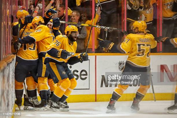 K Subban of the Nashville Predators celebrates with teammate Dante Fabbro of the Nashville Predators after scoring the gamewinning goal in the first...