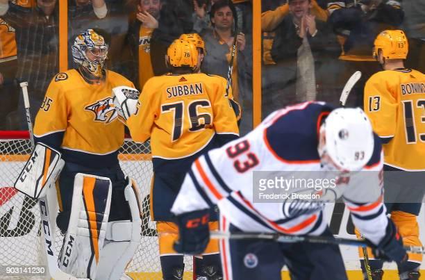 K Subban of the Nashville Predators congratulates teammate goalie Pekka Rinne after a 21 victory over the Edmonton Oilers at Bridgestone Arena on...