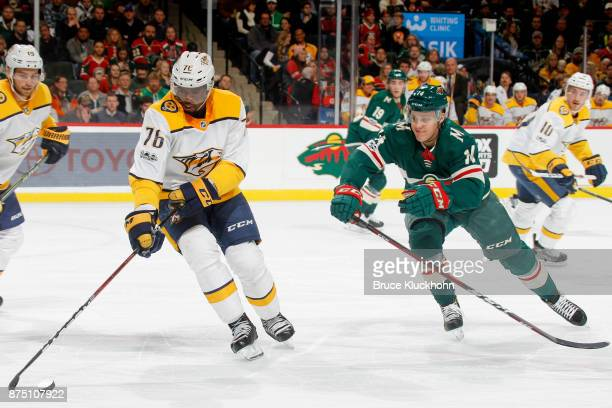 K Subban of the Nashville Predators handles the puck with Joel Eriksson Ek of the Minnesota Wild defending during the game at the Xcel Energy Center...