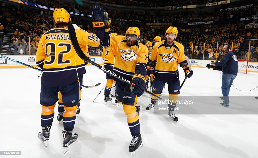 P.K. Subban #76 of the Nashville Predators high-fives Ryan Johansen #92 after an overtime win against the Winnipeg Jets during an NHL game at Bridgestone Arena on March 13, 2017 in Nashville, Tennessee.