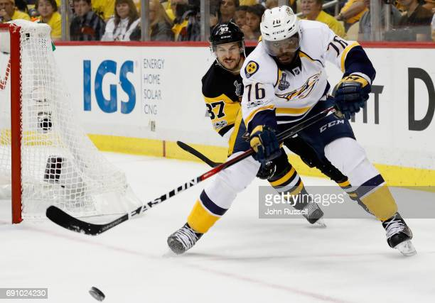 K Subban of the Nashville Predators is chased by Sidney Crosby of the Pittsburgh Penguins during the second period of Game Two of the 2017 NHL...