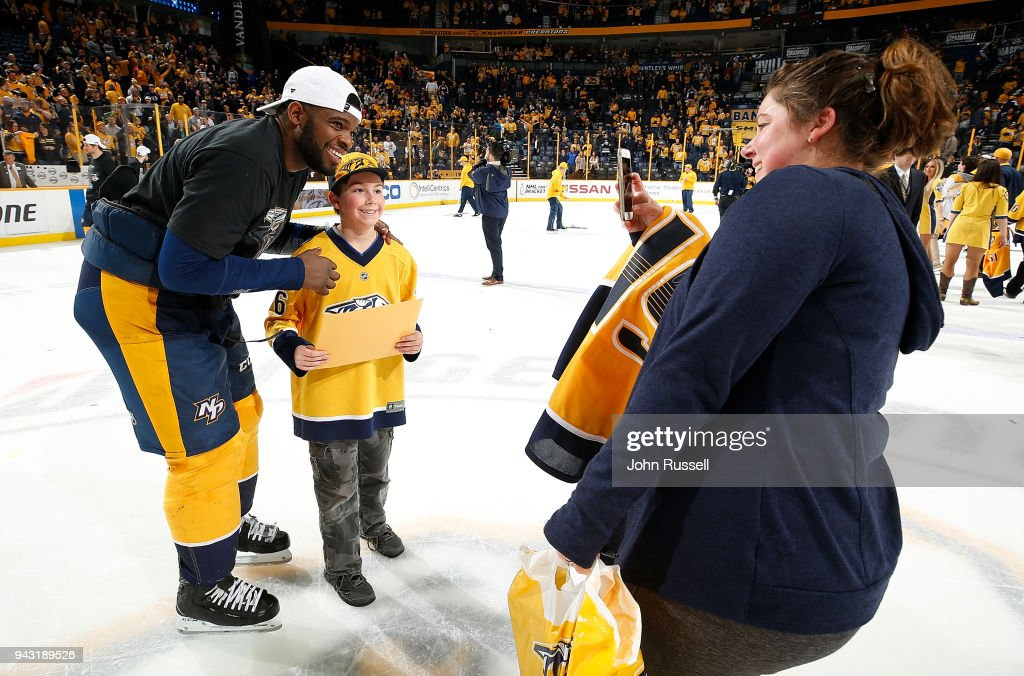 P.K. Subban #76 of the Nashville Predators poses with a young fan after a 4-2 win against the Columbus Blue Jackets during an NHL game at Bridgestone Arena on April 7, 2018 in Nashville, Tennessee.