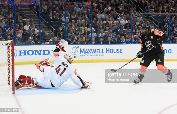 K Subban of the Nashville Predators scores a goal against goaltender Mike Smith of the Calgary Flames during the 2018 Honda NHL AllStar Game between...