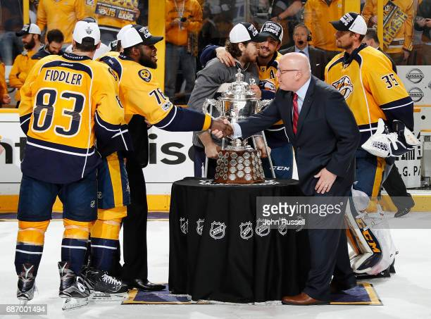 K Subban of the Nashville Predators shakes hands with NHL Deputy Commissioner Bill Daly after the presentation of the Clarence S Campbell trophy...