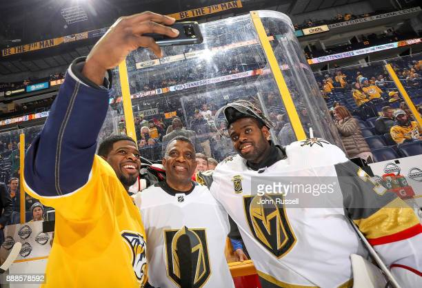 K Subban of the Nashville Predators takes a selfie with his father Karl and brother Malcolm Subban of the Vegas Golden Knights prior to an NHL game...