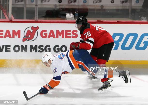 Subban of the New Jersey Devils checks Matt Martin of the New York Islanders during the first period at the Prudential Center on January 24, 2021 in...