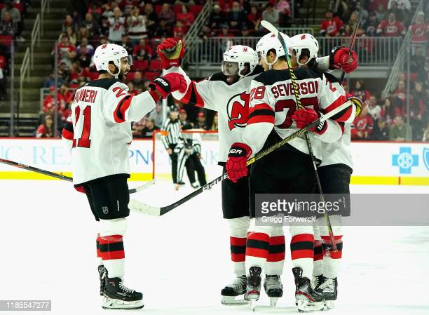 Subban of the New Jersey Devils scores an empty net goal and celebrates with teammates Kyle Palmieri and Damon Severson during an NHL game against...