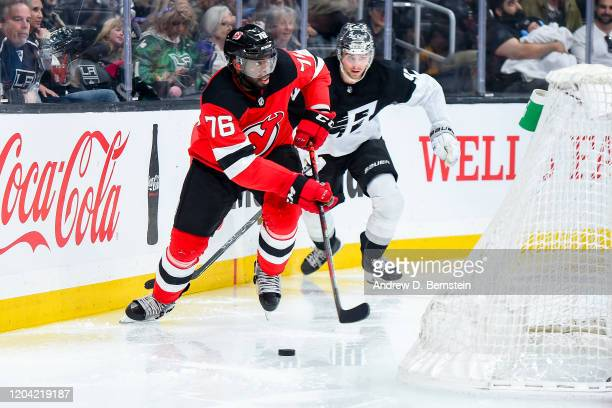 Subban of the New Jersey Devils skates with the puck while pursued by Adrian Kempe of the Los Angeles Kings during the third period of the game at...