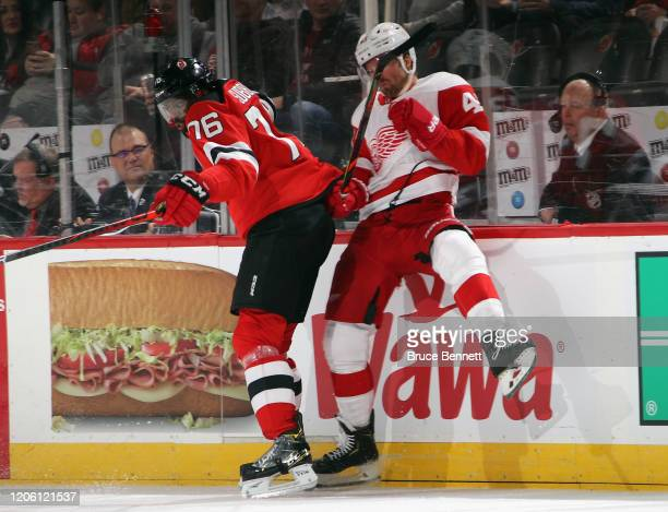 K Subban of the New Jersey Devils steps into Darren Helm of the Detroit Red Wings during the third period at the Prudential Center on February 13...