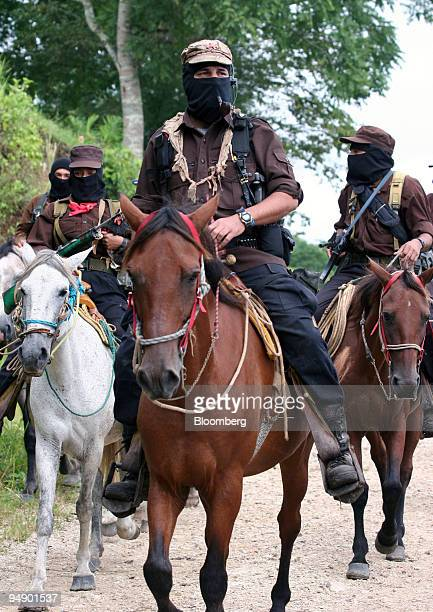 Subcomandante Marcos center of the National Liberation Army arrives on horseback for a meeting with members of the Dolores Hidalgo commune in the...