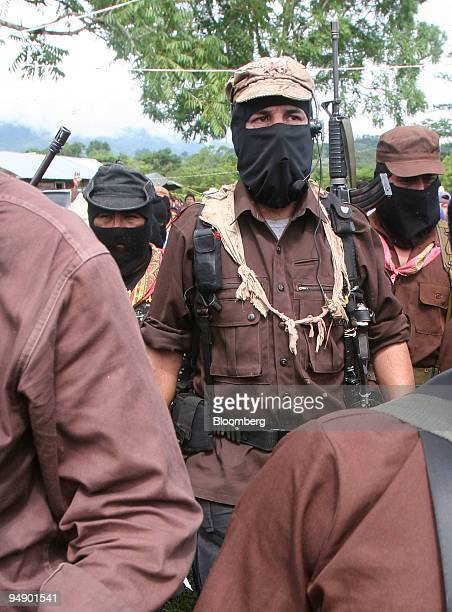Subcomandante Marcos center of the National Liberation Army arrives for a meeting with members of the Dolores Hidalgo commune in the State of Chiapas...