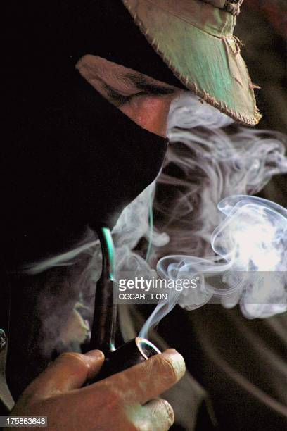 Subcomandante Marcos leader of the Mexican Zapatista Army of National Liberation smokes during the third meeting with social organizations in Dolores...