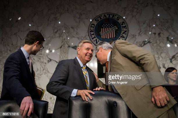 Subcommittee chairman Sen Lindsey Graham and subcommittee ranking member Sen Sheldon Whitehouse arrive for a Senate Judiciary Subcommittee on Crime...