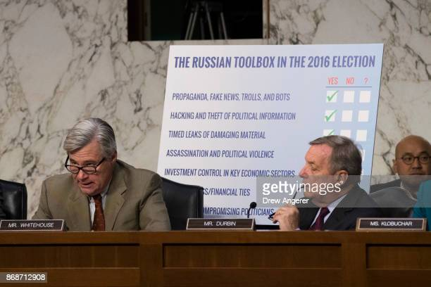 Subcommittee ranking member Sen Sheldon Whitehouse speaks as Sen Dick Durbin looks on during a Senate Judiciary Subcommittee on Crime and Terrorism...