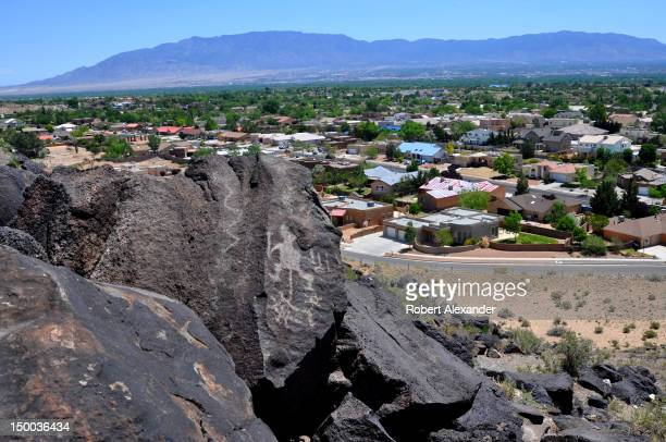 A subdivision development in Albuquerque New Mexico ends at the border of the Petroglyph National Monument which protects the largest petroglyph site...