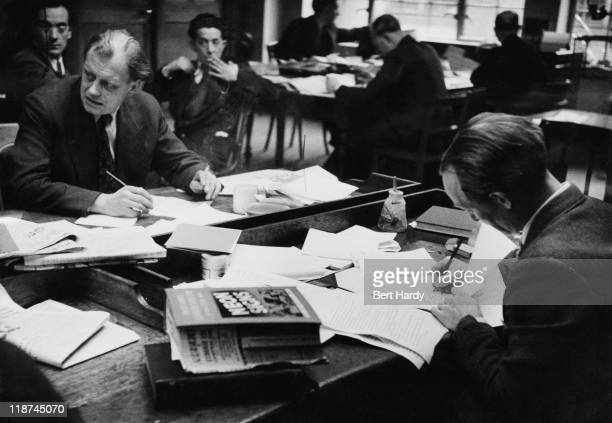 Subeditors at work on a Saturday afternoon in the newsroom at the offices of the News of The World April 1953 Original Publication Picture Post 6488...