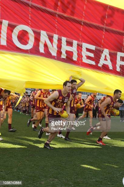 Subiaco run thru their banner during the WAFL Grand Final between Subiaco and West Perth at Optus Stadium on September 23 2018 in Perth Australia