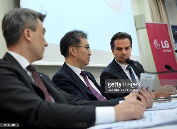 SuBim Park Ji Yong Kim and Oliver Schubert attend a news conference regarding the acquisition of ZKW by LG in Vienna Austria on April 26 2018 /...