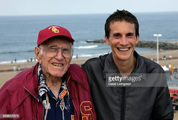 Subject of the Angelina Jolie film Unbroken Louis Zamperini poses with distance runner Brian Livingston at the Keep LA Running 10k on July 13 2008 in...