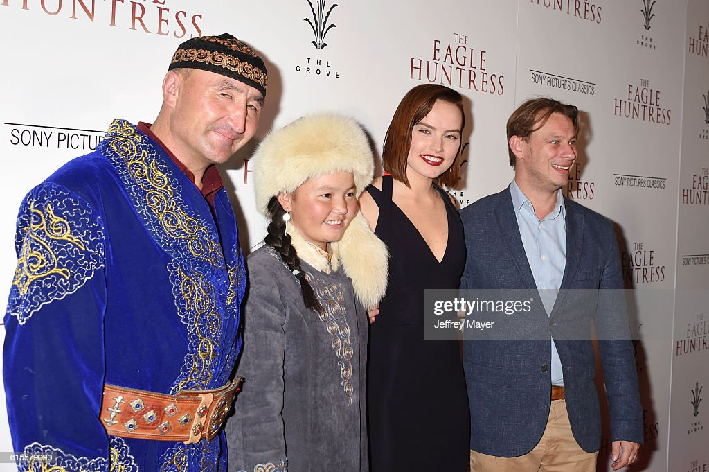 Subjects of the film Nurgaiv Rys, Aisholpan Nurgaiv, actress/narrator Daisy Ridley and director Otto Ball arrive at the Premiere Of Sony Pictures Classics' 'The Eagle Huntress' at Pacific Theaters at the Grove on October 18, 2016 in Los Angeles, California.