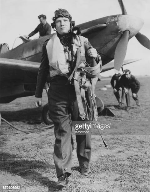 SubLieutenant Colin Hodgkinson of the RAF leaves his Spitfire after a training flight UK World War II 7th October 1942 Hodgkinson is a doubleamputee...