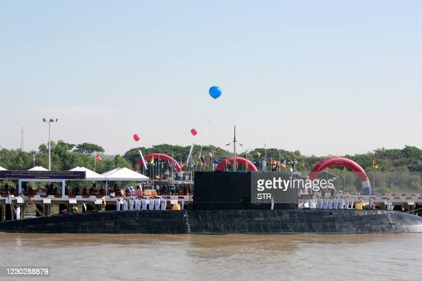 Submarine is docked during the welcoming ceremony for new warships to mark the Myanmar Navy's 73rd anniversary at the Irrawaddy Naval Region Command...