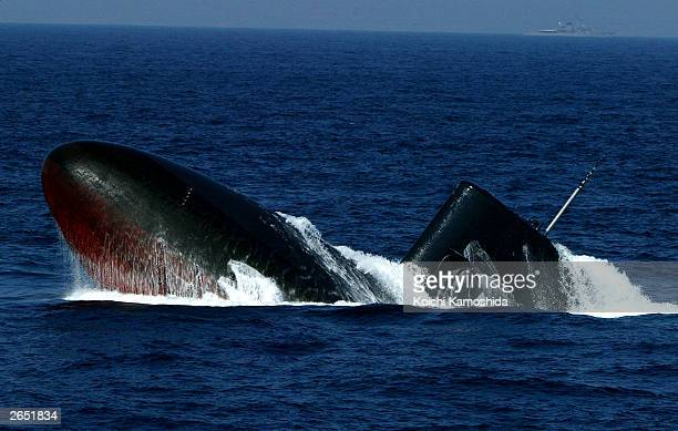 A submarine of the Japanese Maritime Defence Force surfaces during a naval review on October 26 2003 off Sagami Bay Japan Prime Minister Koizumi...